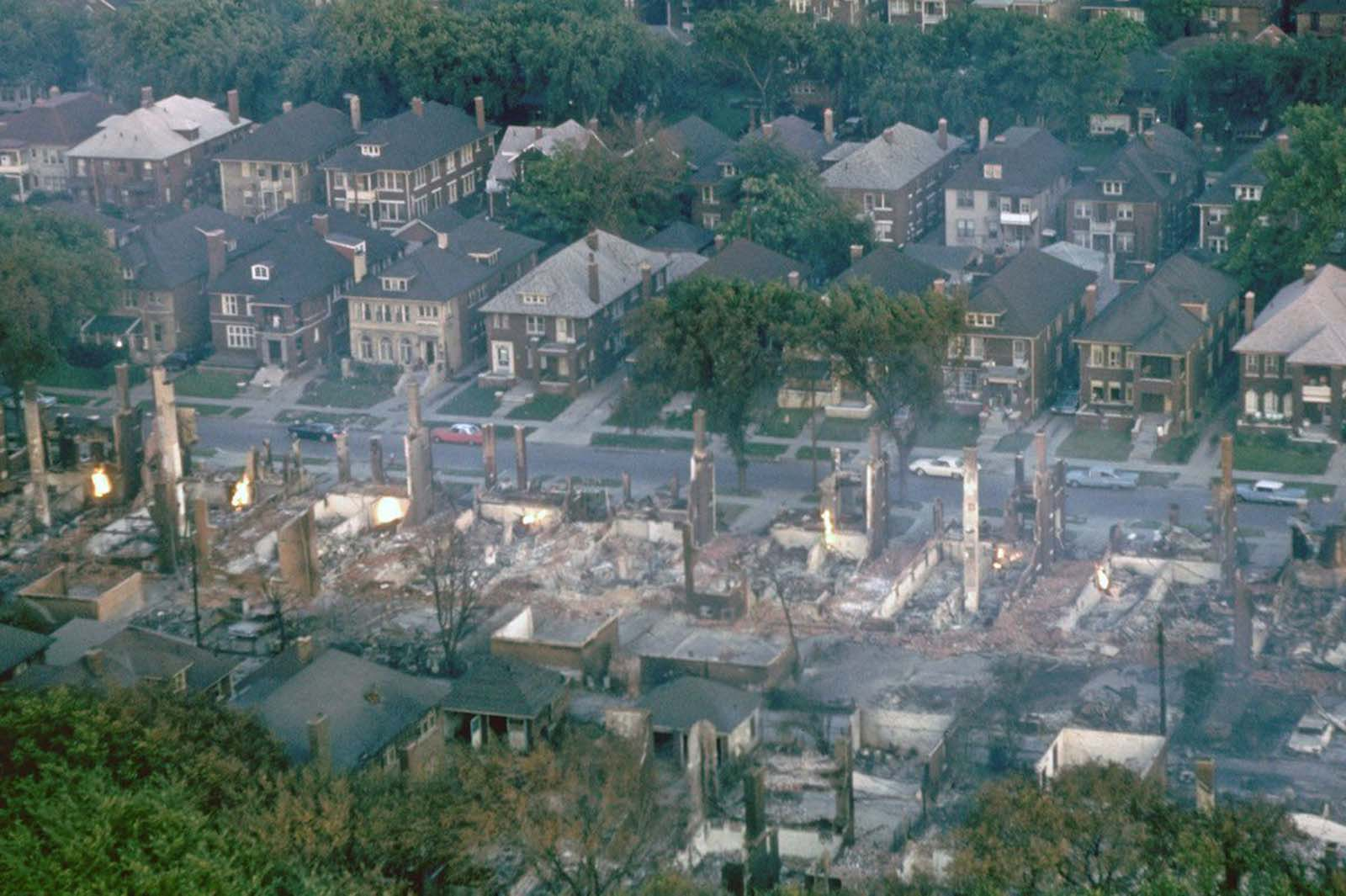 Smoldering ruins of a middle-class black neighborhood.