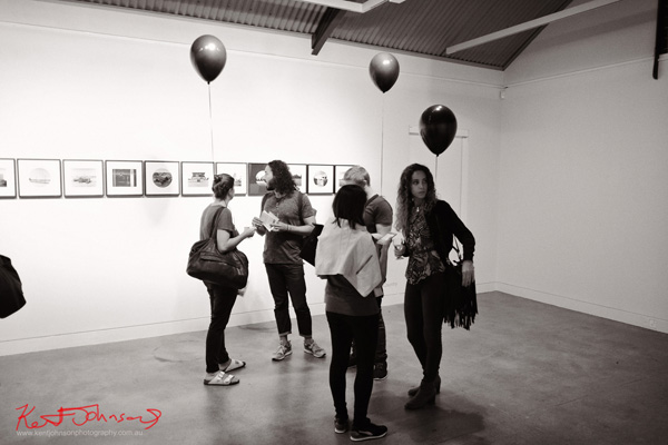 Art patrons with black balloons survey Jane Browns photographic series, Sporting Country.