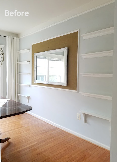 shallow shelves on wall, oak hardwood floors, white curtains, sphere chandelier