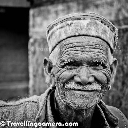 This photograph was clicked last year in winters while I was in a small village of Himachal Pradesh. He was probably oldest person of village called Sarahan in Kullu District. He is still very active at this age and regularly visit his agricultural land near his village. Daily he brings wood or grass while coming back home. I loved the smile when I was clicking this photograph. Simplicity of life in Himalayas is unmatchable. People in hills have enough for their livings and they are quite happy with it, which is the key.