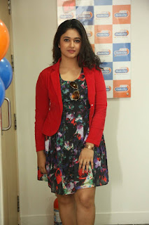 Actress Poonam Bajwa Pictures in Floral Dress at Radio City FM For Kalavathi Movie Promotion  0017