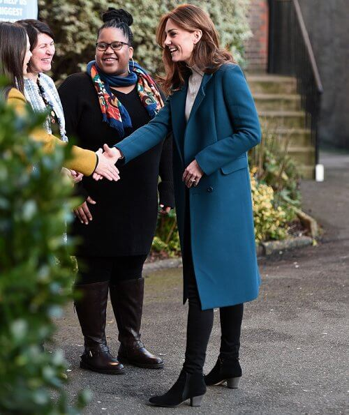 Kate Middleton wore Sezane Tulio jumper, Russell and Bromley FAB Dry ankle boots, Accessorize Filigree gold earrings, a blue wool coat