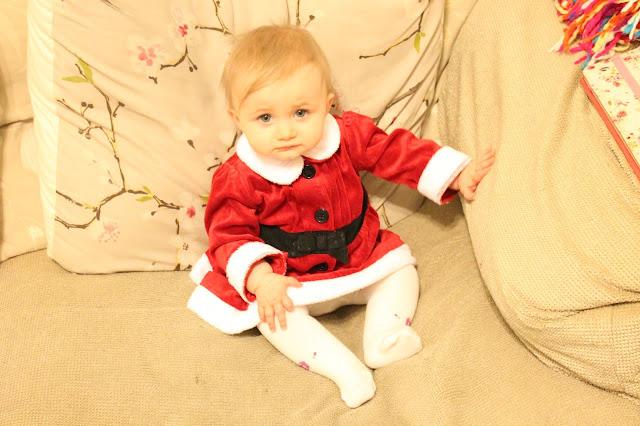 baby girl wearing little miss santa dress from matalan