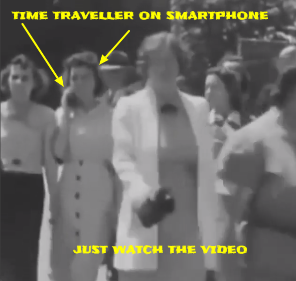 Woman time traveller caught talking in to a cell phone in an old black and white film.