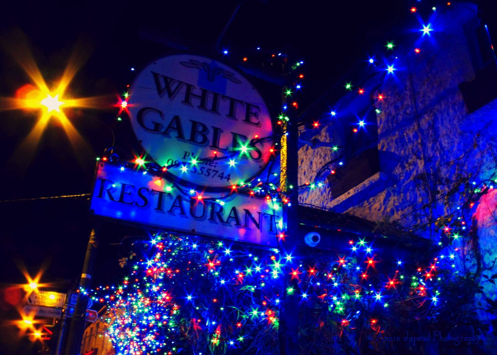 White gables sign with Christmas lights