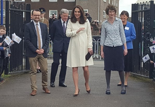 Kate Middleton wore JoJo Maman Bebe Maternity Princess Coat, with her Annoushka pearls and Kiki McDonough hoops and carried suede Emmy clutch
