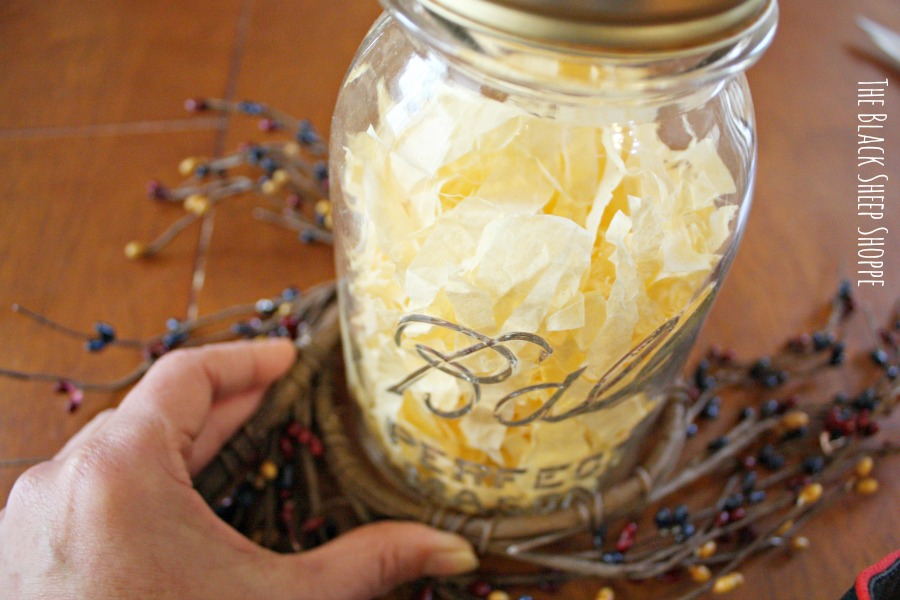 Wrap the pip berry garland around the mason jar to create a round opening.