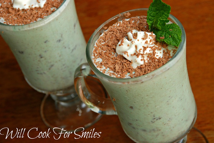 grasshopper in a glass with whip cream and chocolate shavings on top with a mint leaf as a garnish