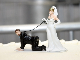 Bride leading groom on a leash wedding cake