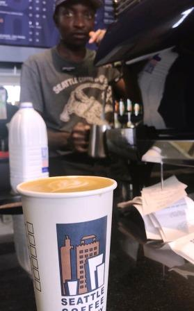 coffee and barista in background
