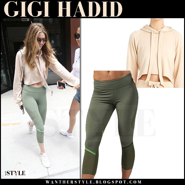 Gigi Hadid in cropped beige hoodie and green leggings reebok what she wore july 27 2017
