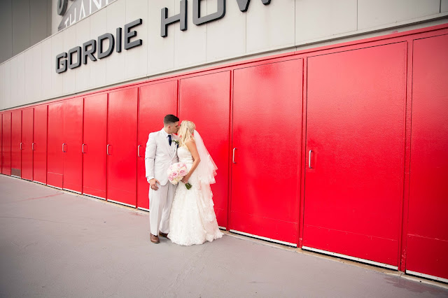 bride and groom at Joe Louis Arena big red doors
