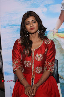 Actress Heba Patel Latest Stills in Red Dress at Mister Movie Trailer Launch Event  0015.jpg