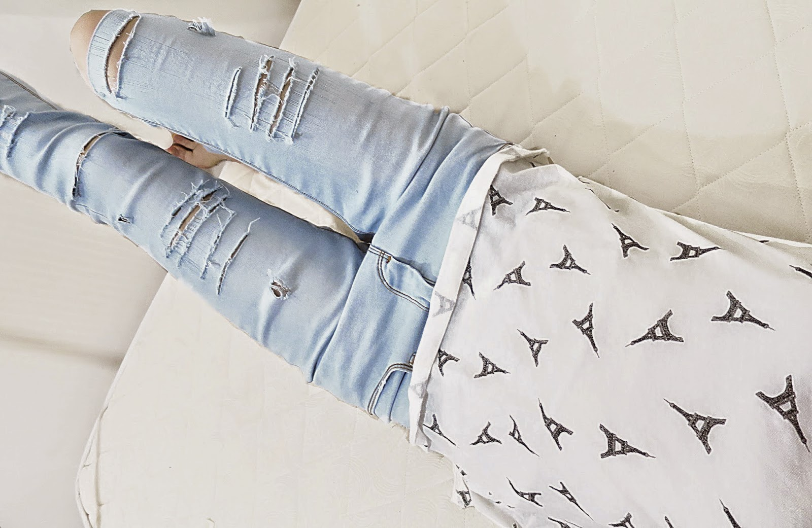 Photo of Fii wearing distressed Jeans and a Eiffel Tower Tee both from Forever21