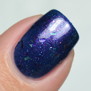 blue nail polish with shifting flakies and shimmer