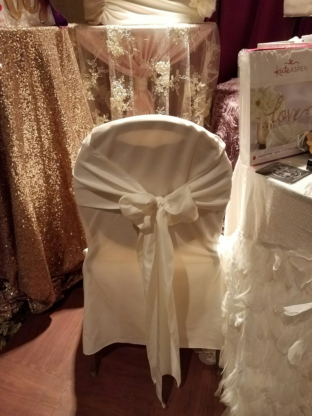 ivory chair covers with gold sash make up chairs i do events tablecloths wedding table