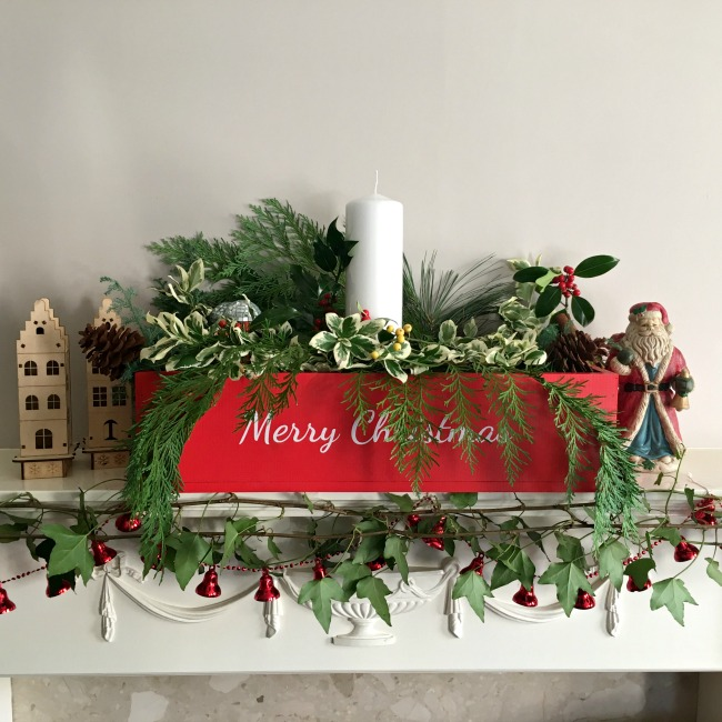 image-of-empty-Plantabox-personalised-wooden-apple-crate-red-table-centrepiece-with-white-text-Merry-Christmas-full-of-fresh-greenery-and-christmas-decorations