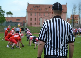 A referee watch over an american football game.