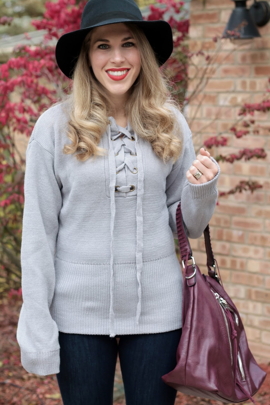 grey lace up sweater, express skinny jeans, black suede booties, burgundy bag, black felt wide brim hat