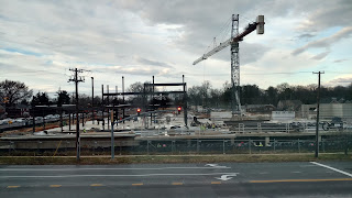 Steel girders begin to rise at the site of the new Wheaton Library