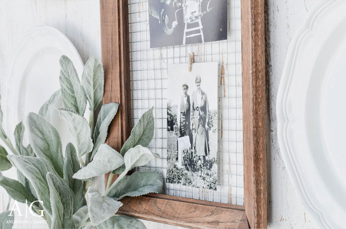 An old wood frame has been turned into a unique way to display photos with a little hardware cloth and clothespins.