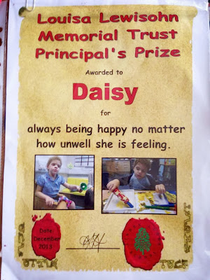 Daisy's prize certificate for smiling despite everything she goes through