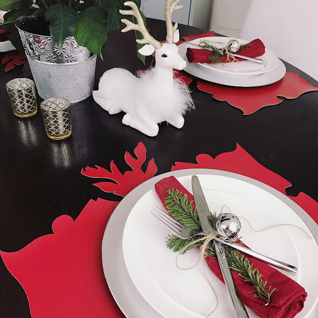 i tied a sprig from my fir tree to the napkins and flatware with a piece of jute thread and accented it with a silver christmas bell decoration - Red And Silver Christmas Table Decorations