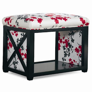 wooden ottoman with red floral fabric