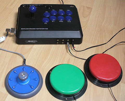 Black arcade stick with blue joystick and buttons, adapted, and with a low-profile external round joystick attached with large switches.