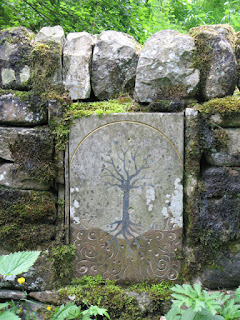 Tree of Life On the Allendale Nature Trail, about 100 yards along the riverside path from Bridge End, is this carved sandstone tree set into a drystone wall. Inspired by the Celtic name Allen, which means shining water, Sarah Turnbull, aged 8, designed this tree. It is inlaid with lead as a reminder of Allendale's lead mining past, and its roots, which become rapids, are brushed with silver leaf.
