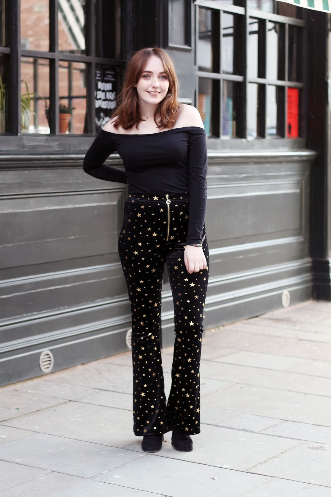 New Years outfit with toyshop black and gold star print velvet flared trousers