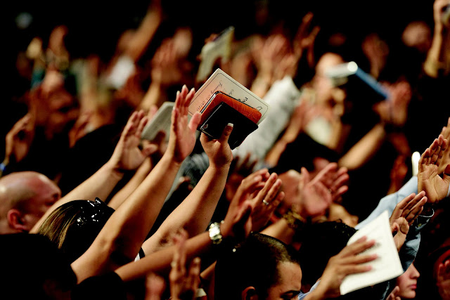 People lifting up their hands to worship God