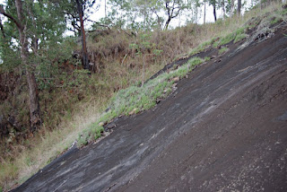red earth on a steep slip plane