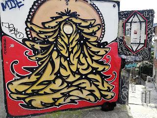 faceless madonna with cat street art