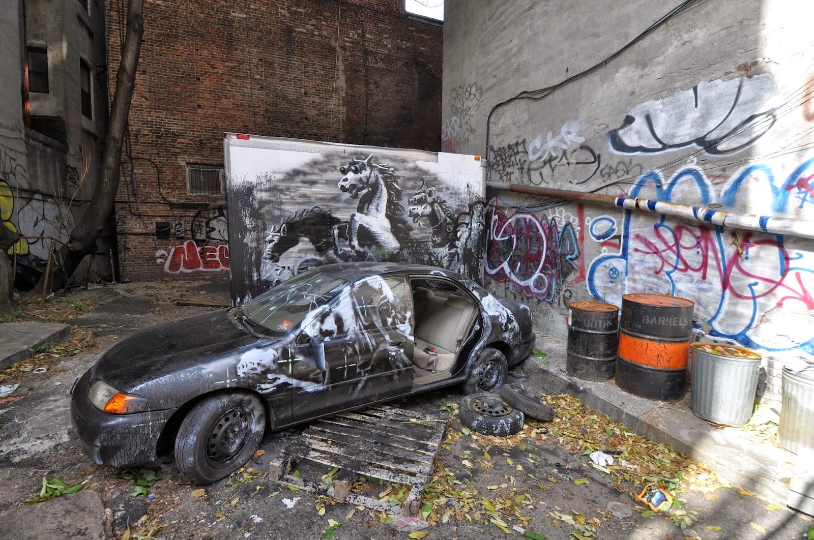 ev grieve someone apparently took a car door off the banksy mobile on ludlow street. Black Bedroom Furniture Sets. Home Design Ideas