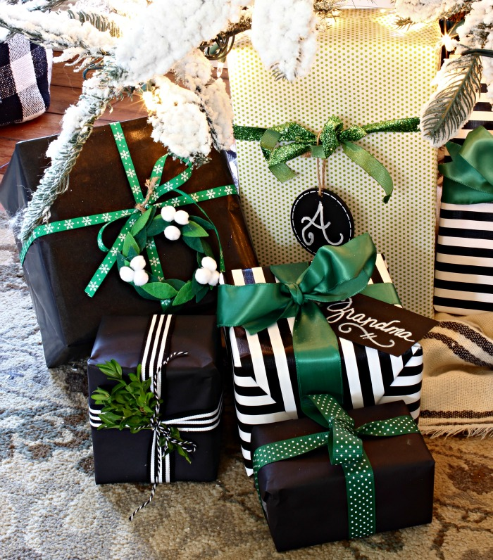 Noel Target pillow, green, black and white presents under flocked tree - www.goldenboysandme.com
