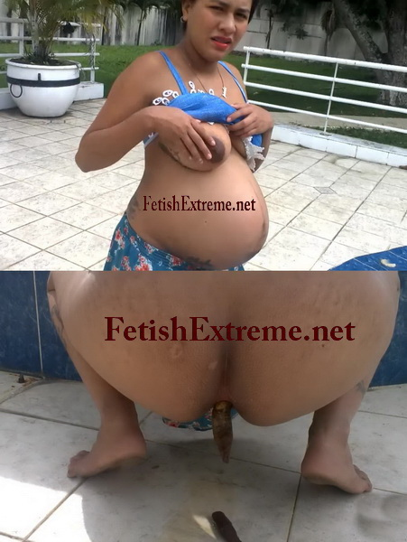 This scat video shows big bellied pregnant woman is pissing and shitting