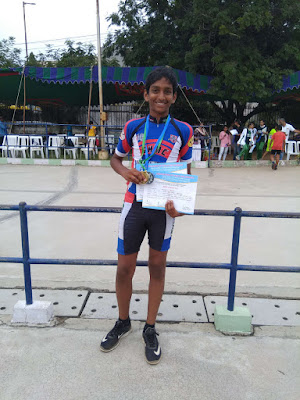 abhiram with gold silver medals