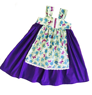 http://www.knot-dresses.com/dresses-and-tops/fall-apron-knot-dress-for-girls-purple-floral/