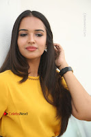 Actress Poojitha Stills in Yellow Short Dress at Darshakudu Movie Teaser Launch .COM 0175.JPG