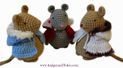 three crochet mice with crochet capes on