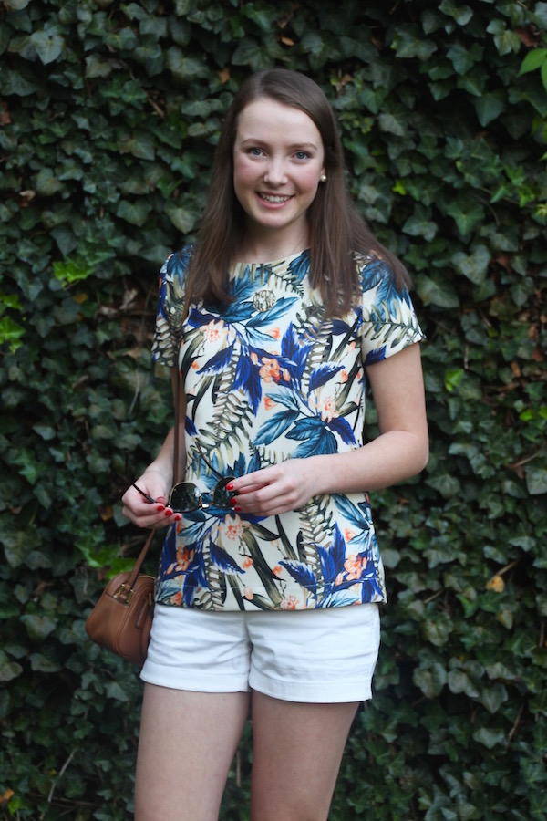 Gimme Glamour: Tropical Top. Palm leaf top with Vineyard Vines Shorts, Clubmaster sunglasses and Tory Burch cross body.