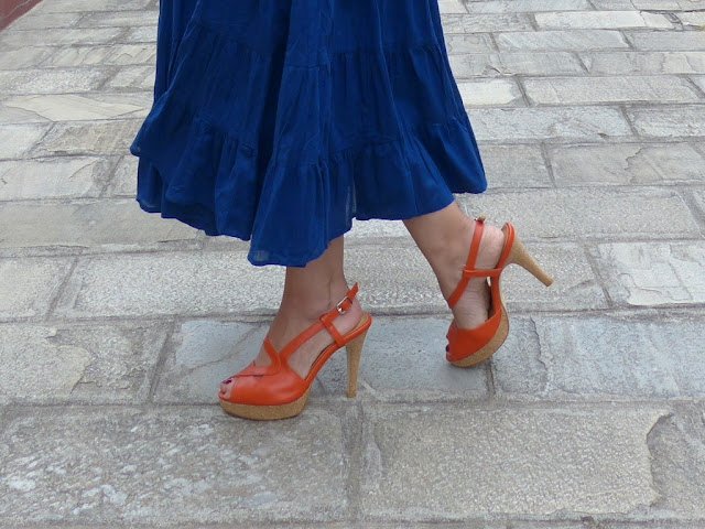 Orange shoes worn with blue maxi dress