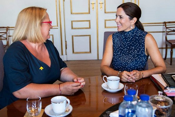 Crown Princess Mary met with Katja Iversen who is the CEO of Women Deliver at the Amalienborg Palace in Copenhagen. Blue print dress