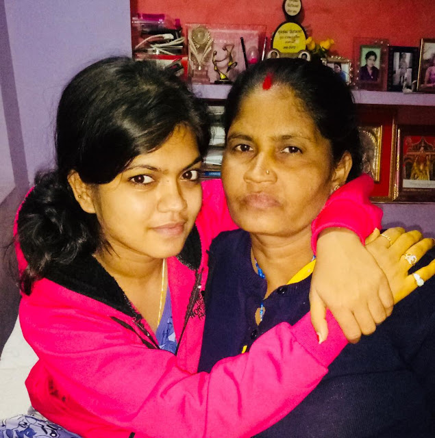 Nisha Dubey with his mothers image