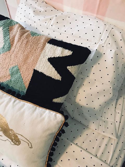 Mixed patterns with boho vibe, dot sheets, and pink buffalo check