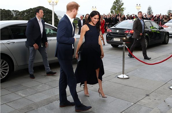 Meghan Markle wore Antonio Berardi breasted sleeveless dress, Aquazzura Deneuve pumps, and Dior clutch