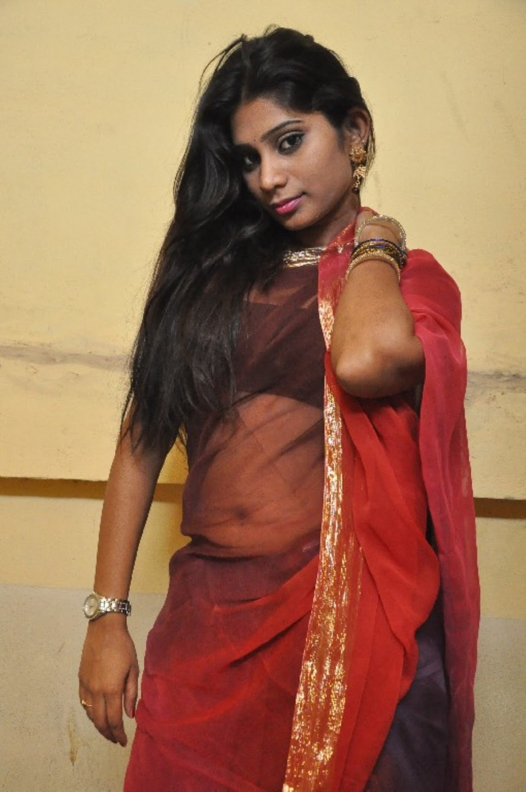 Midhuna Waliya Hot Navel Show Photos In Transparent Saree -5584