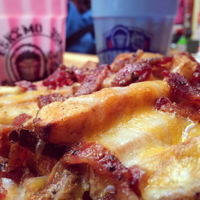 The legendary Sweet Pepper Bacon Cheese Fries at Eskimo Joe's