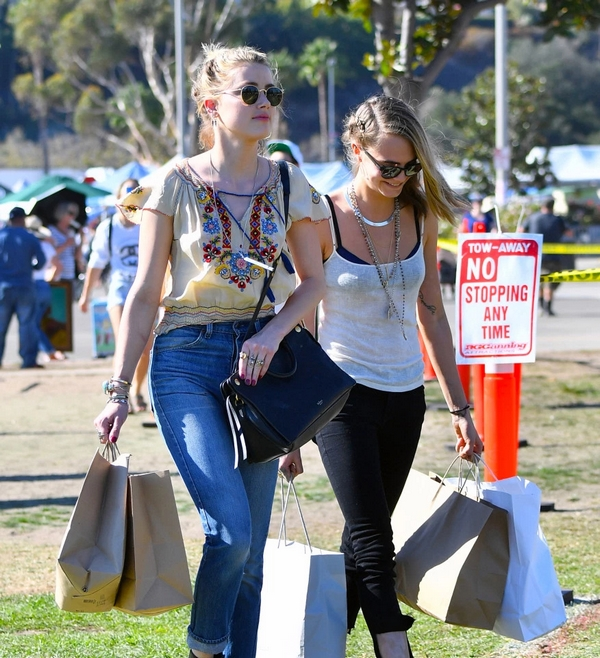 Amber Heard and Cara Delevingne Friends